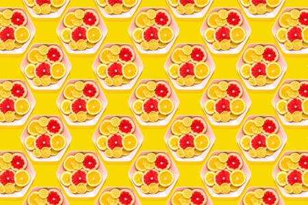 Pattern tropical fruits whole and slices on plates