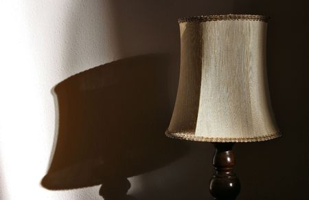 bedside lamp: bedside lamp with its shadow