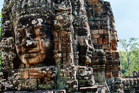 Historic building in Angkor wat Thom Cambodia with devatas carvings stone faces serenity milk ocean