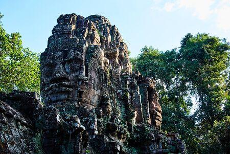 Historic building in Angkor wat Thom Cambodia with devatas carvings stone faces serenity milk ocean