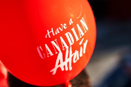red Canadian affair flag white scripture balloon Standard-Bild