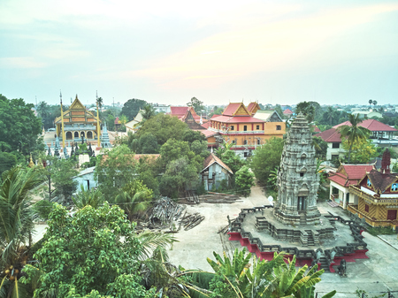 Aerial drone view topdown eagle eye of a traditionnal temple pagoda cemetery in siem reap cambodia asia