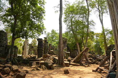Koh Ker is situated between the southern slopes of the Dangrek mountains, the Kulen mountains (Phnom Kulen) in the south-west and the Tbeng mountain (Phnom Tbeng, near Tbeng Meanchey) in the east. Most parts of the hilly ground are covered by jungle, but most of the trees shed their leaves seasonally. In the second part of the 19th century, as French researchers and adventurers ranged the forests around the site of Koh Ker the game population was impressive. The city of Koh Ker was passed by the most important strategic route of the Khmer empire. Coming from Angkor and Beng Mealea to Koh Ker this road led to Prasat Preah Vihear and from there to Phimai in Thailand and Wat Phu in Laos .[1](pp13–14) The region of Koh Ker is relatively dry. Numerous water-tanks and canals were built during the 9th and the 10th century to ensure the water supply. These days water is pumped up from a depth of 30 to 40 metres (98 to 131 ft) meters