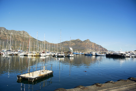 Hout Bay (Afrikaans: Houtbaai, meaning Wood Bay) is a town near Cape Town, South Africa situated in a valley on the Atlantic seaboard of the Cape Peninsula, twenty kilometres south of the Central Business District of Cape Town