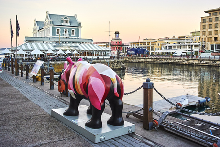 The rhinos pictured are part of our first eight spectacular painted Rhinos, sponsored by leading companies and painted by local artists both famous and emerging. They are our rhino ambassadors and have already made their way all around the Mother City and Banque d'images - 103031386