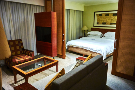 A suite in a hotel or other public accommodation such as a cruise ship denotes, according to most dictionary definitions, connected rooms under one room number. Hotels may refer to suites as a class of accommodations with more space than a typical hotel r