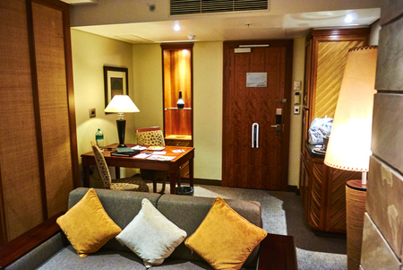 A suite in a hotel or other public accommodation such as a cruise ship denotes, according to most dictionary definitions, connected rooms under one room number. Hotels may refer to suites as a class of accommodations with more space than a typical hotel r Banque d'images - 103031392