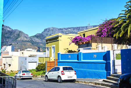 The Bo-Kaap is known for its brightly coloured houses – think pink, green, blue and orange. Other tour highlights include Auwal Masjid (the first and oldest mosque in South Africa), the Bo-Kaap Museum and the spicy delights of Cape Malay food. Banque d'images - 103031408