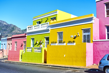 The Bo-Kaap is known for its brightly coloured houses – think pink, green, blue and orange. Other tour highlights include Auwal Masjid (the first and oldest mosque in South Africa), the Bo-Kaap Museum and the spicy delights of Cape Malay food. Banque d'images - 103031414