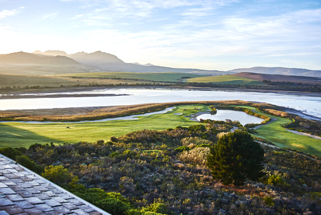 Arabella Hotel & Spa is overlooks a spectacularly attractive natural lagoon, surrounded by a lush landscape. The hotel boasts a 18-hole golf course designed by Peter Matkovich. Banque d'images - 105962785