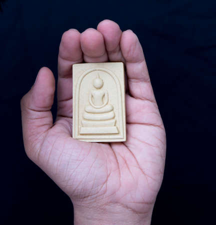 amulet: thai amulet in hand with respect