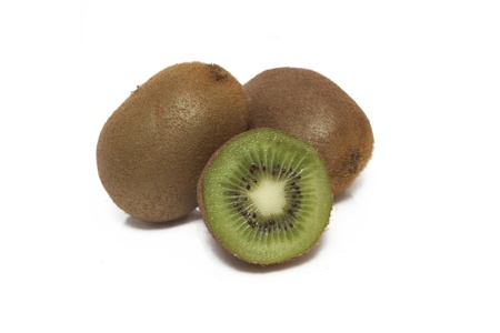 unsliced: Sliced and unsliced fresh kiwis isolated on a clean white background.