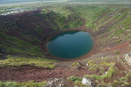 Beautiful volcanic crater with small lake located in southern Iceland