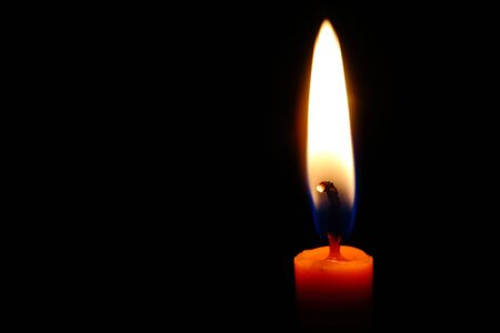 candle flame on a black background .