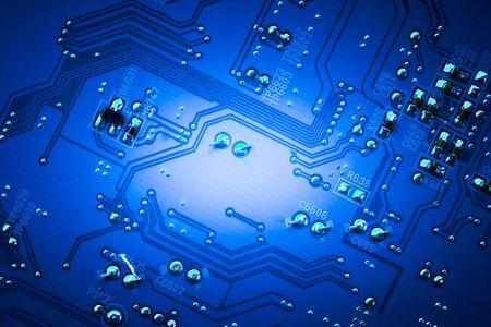 Closeup electronic circuit board background.