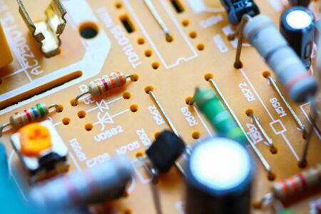 Closeup electronic circuit board background.