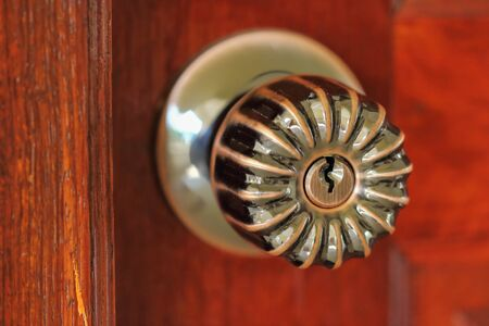 lath in modern: Doorknob , a hole for inserting the key . Stock Photo