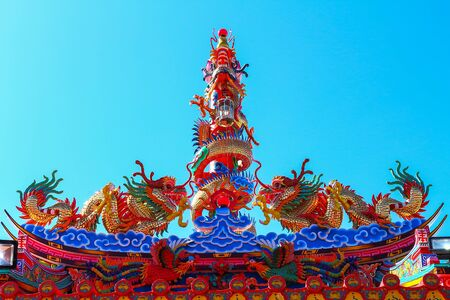 Colorful dragon head in  temple. statues in chinese shrine in Thailand.