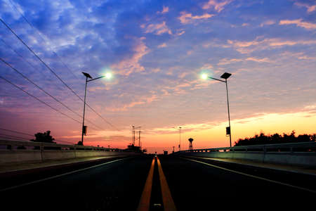 Sunrise. Road bridge across the river. Stock Photo
