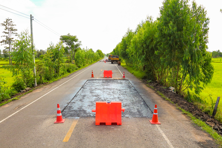 Surface preparation for road repairs by asphalt flooring.