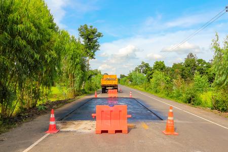 blacktop: Surface preparation for road repairs by asphalt flooring.