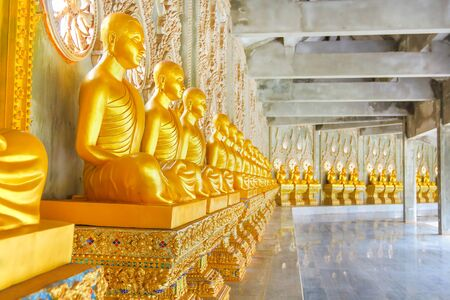 Golden Buddha statue meditation in measure Thailand. Stock Photo