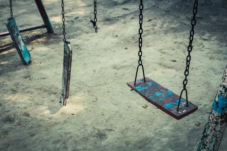 Broken chain swing playground in school.