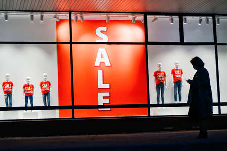 Sale banner in showcase of the shopping mall