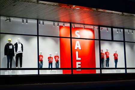 Orange color of sales banner in store window