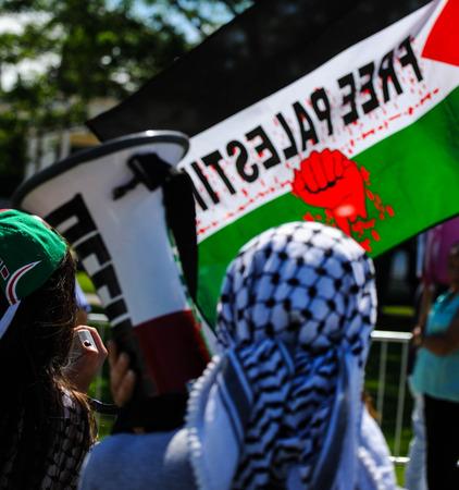 덴버에서의 팔레스타인 시위자 에디토리얼