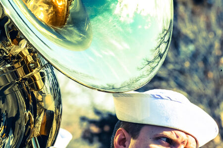 Sailor playing tuba Imagens