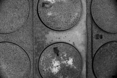 Series of round burner plates on pioneer wood burning stove