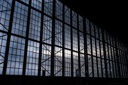 multiples: Silhouette of  hanger with blue clouds in background Stock Photo