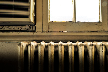 destitute: Impoverish Room with Radiator, Air Conditioner, Window