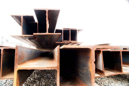 doublet: Collection of Steel Beams against White Sky Stock Photo