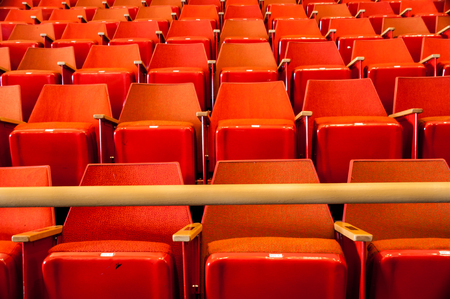 Rows of Red Seats in Cinema with Yellow Safety Pole Imagens