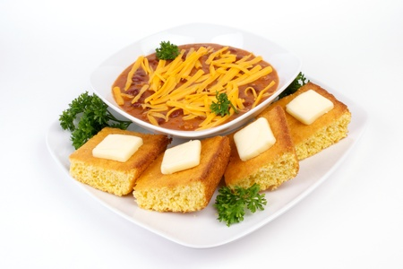 Red Chili and Cornbread Meal on White Dinnerware
