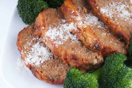 Meatloaf sprinkled with grated parmesan cheese