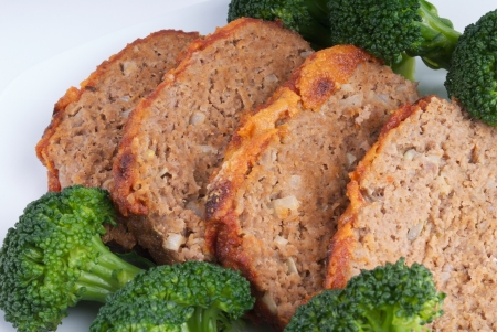 Meatloaf with a tomato and grated parmesan cheese topping Banco de Imagens