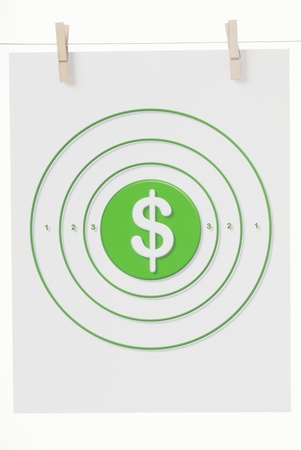 The Dollar Sign in White on a field of green in the Bulls Eye of a paper target hanging from clothes pins on a wire