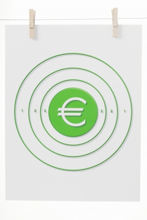 The Euro Monetary Symbol in the Bulls Eye of a paper target hanging from clothes pins on a wire