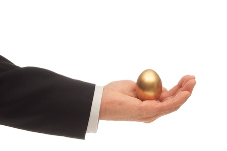 Golden Egg Nested in the Palm of a Hand Stock Photo - 20916357