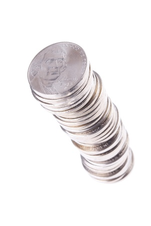 Nickels Stacked on White Background with a Lower Right to Upper Left Orientation Stock Photo - 21266447