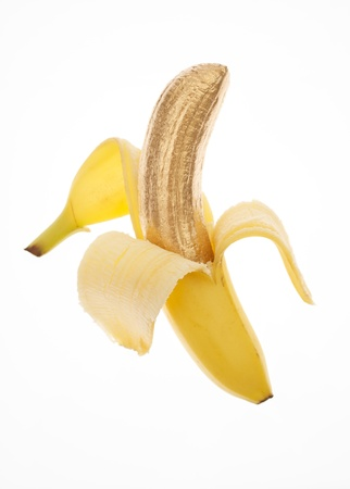 banana skin: Banana Skin Peeled Back to Show Golden Fruit