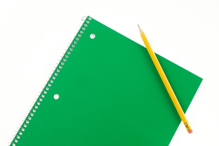 Green Spiral Notebook and Pencil with Room For Copy Stock Photo