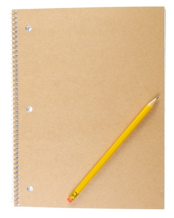The Back Cardboard Cover of a Spiral Notebook with a Pencil Stock Photo