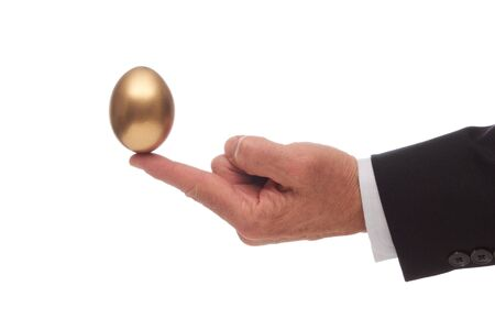 Golden Egg Balanced on the Outstretched Index Finger of a Man