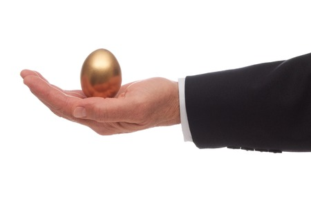 A Golden Egg Resting in the Palm of a Hand