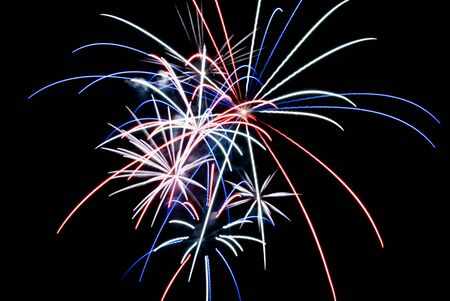 Aerial Fireworks Exploding with Red White and Blue Colors