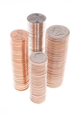 Four Stacks Each of Pennies Nickels Dimes and Quarters Stock Photo
